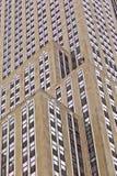 Facciata del grattacielo con la statua Fotografia Stock
