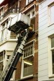 Facciata della Camera con una macchina di sollevamento a Amsterdam, Olanda Fotografia Stock