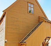 Facciata di una casa di legno Immagine Stock