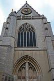 Facciata ed orologio della chiesa medievale di St Peters a Lovanio, Fotografie Stock