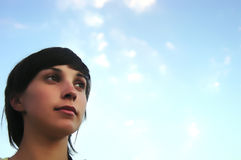 Face. Young teen woman with the blue sky as background Royalty Free Stock Photos