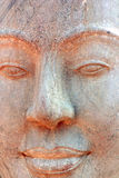 Face. Buddha face carved from sandstone in rural Cambodia Stock Photography
