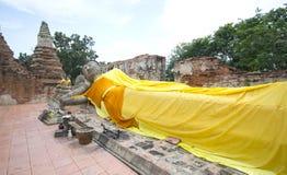 Face. Reclining Buddha image with blue sky, Ayutthaya, Thailand Stock Image