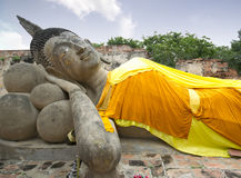 Face. Reclining Buddha image with blue sky, Ayutthaya, Thailand Stock Photography