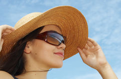 Face. Portrait of young beautiful woman in straw hat and sunglasses Stock Images
