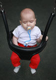 Face of adorable baby with pacifier in mouth, eyes closed Royalty Free Stock Image