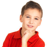 Face of adorable young boy. Face of adorable young smiling boy looking at camera isolated on white background royalty free stock images