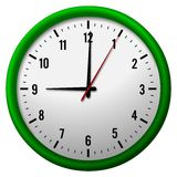 Face of analog clock. An isolate view of the face and hands of an analog, 12-hour clock with a round, green frame Royalty Free Stock Photography