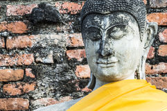 Face of ancient Buddha statue. Face of one of ancient statue in Wat Yai Chaimongkol, Ayutthaya, Thailand royalty free stock images