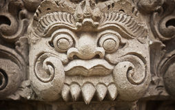 Face of the ancient deities carved in stone. Indonesia, Bali Royalty Free Stock Image