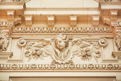Face of angel on facade of historical building Royalty Free Stock Photography