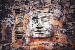 Face of Angkor Wat. The Bayon (Khmer language - Prasat Bayon) is a well-known and richly decorated Khmer temple at Angkor in Cambodia. Built in the late 12th Stock Images