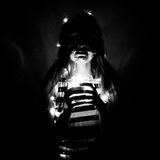 Face art girl with a glass jar in a hands with lights at night, black and white stock photo
