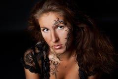 Face art portrait. Portrait of a woman with floral face art Stock Photos