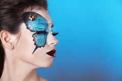 Face art portrait. Fashion Make up. Butterfly makeup on face Stock Images