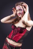 Face Art Project: Sexy Caucasian Brunette Woman In Corset Painte Stock Photography