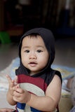 Face of asian baby sitting in home living room Stock Photo