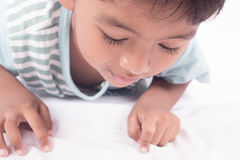 face asian boy lying on floor Royalty Free Stock Photography
