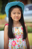 Face of Asian girl with long hair wearing blue cowboy hat Royalty Free Stock Images