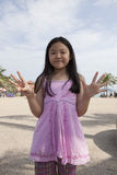 Face of asian girl show finger acting as a symbolic of number Royalty Free Stock Photography