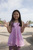 Face of asian girl show finger acting as a symbolic of number Royalty Free Stock Images