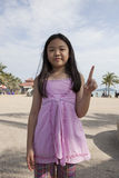 Face of asian girl show finger acting as a symbolic of number Royalty Free Stock Photo