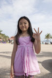 Face of asian girl show finger acting as a symbolic of number Stock Images