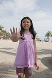 Face of asian girl show finger acting as a symbolic of number Stock Image