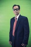 Face of asian man wearing dark suit Royalty Free Stock Photos