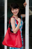Face of asian woman and red leather fashion bag Stock Image