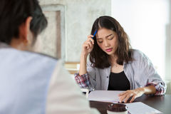 Face of asian younger woman seriously thinking in family problem. Face of asian younger women seriously thinking in family problem royalty free stock images