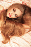 Face of attractive girl with magnificent long hair Royalty Free Stock Image