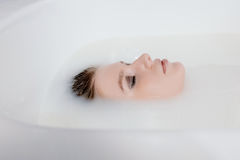 Face of Attractive woman in milk bath Royalty Free Stock Photo