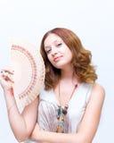 Face ausente da escova da menina pelo ventilador Fotografia de Stock Royalty Free