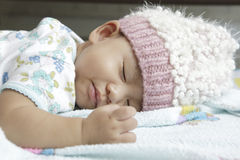 Face of baby asleeping on bed Stock Photos