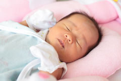 Face of baby infant close her eye royalty free stock photo