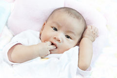Face of baby lied on bed Royalty Free Stock Image