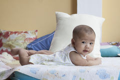 Face of baby lied on bed use for new born and healthy topic stock images