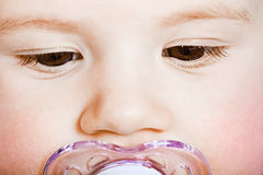 Face baby with pacifier closeup. macro Stock Image