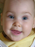 Face baby smile with two teeths. Closeup royalty free stock image