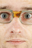 Face in bad old glasses close-up Royalty Free Stock Images
