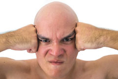 Face of a bald man in white background. Angry man with his hands on his head Stock Photos
