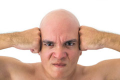 Face of a bald man in white background. Angry man with his hands on his head Royalty Free Stock Photo