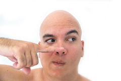 Face of a bald man in white background. Finger pointing to the right Stock Photos