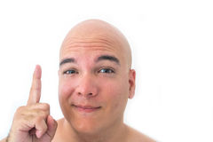 Face of a bald man in white background. Finger pointing to top Royalty Free Stock Image