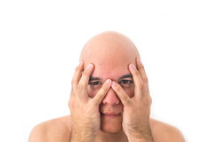 Face of a bald man in white background. Hands over the face Stock Photo