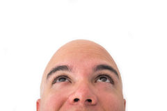 Face of a bald man in white background. Looking to the top Royalty Free Stock Photo