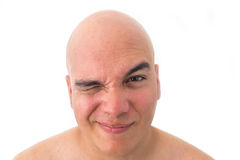 Face of a bald man in white background. Suspicious face Stock Images
