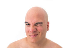 Face of a bald man in white background. Winking the eye Royalty Free Stock Photo