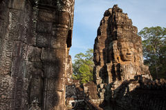 The Face of Bayon Temple. From the vantage point of the temples upper terrace, one is struck by the serenity of the stone faces occupying many towers Stock Images
